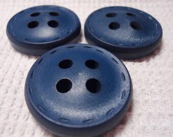 "Large 4 hole coat button, matte royal blue color,  'saddle stitced', just over 1"" ins across.     PFM12.1-29.27."