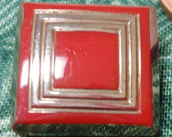 Square vintage glass red with silver toned luster, button.   Shank on the back.   KAM12.4-14.8.