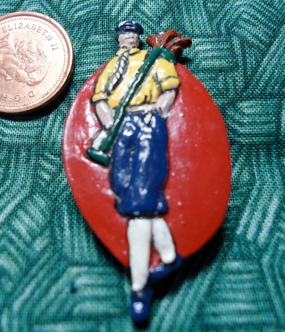 "Golfer, button cover. Great for re-purposing.1.75"" ins X 1"". Wearing knickerbockers, plus fours, with clubs. STEVETSS12.2-10.1"