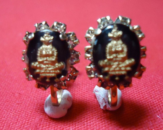 """Vintage earrings, oriental influence. Black back ground, with  oval rhinestone ring.0,5"""" ins X 0.25"""" ins across.   RFM12.1 -29.14."""