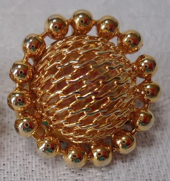 """Gold toned clip on earrings. Vintage, domed,  open mesh center,  beads round the rim. 0.75"""" inches across.   RYC12.4-20.1."""
