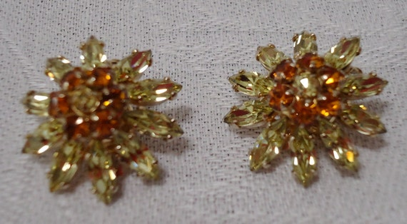 """SHERMAN stamped, amber and green crystal, vintage clip on earrings, daisy style design.  0.75""""  ins across. FPAVI12.3-15.5."""