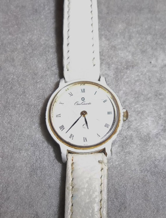As-Is 1970s Lady's Wrist Watch, White Enamel, White Leather Band.