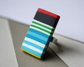 Ring with red, blue, green, white, yellow and black stripes, geometric statement ring
