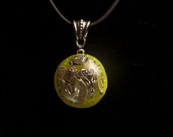 Treasure Chest Pendant on a Black Rubber Necklace