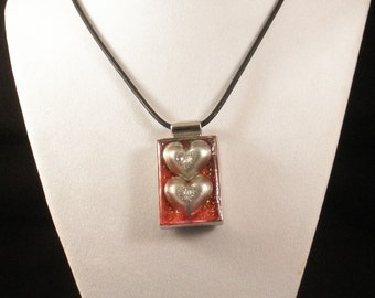 Two Hearts Pendant on a Black Rubber Necklace