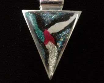Hand-painted triangular pendent on a black rubber cord.