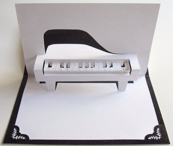 GRAND PIANO 3D Pop Up Greeting Card For Music Lovers Home Décor Handmade Hand Cut Origamic Architecture In White And Bright Shimmery Black.