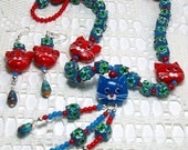 Blue and red cat face necklace and earrings set with lampworked glass kitty faces.