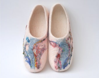 Felted slippers from natural white wool, shiny