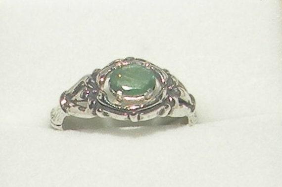 unique emerald ring
