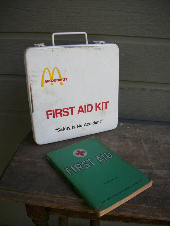 American Red Cross First Aid book and vintage first aid kit
