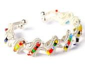 Beaded aluminum bracelet . multi color . wrap bangle . adjustable size . silver . small beads . tin . gift . jewelry . rainbow . modern .