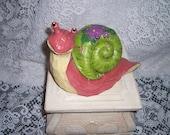 Happy chiseled snail concrete yard art statuary