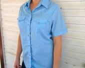 Women's vintage pearl snap shirt