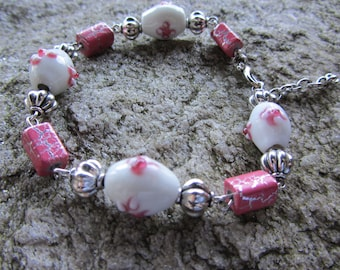 One of a kind Bracelet with White bead, pink flowers, silver fluted bead, pink crackle beads with adjustable length