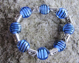 Blue glass bead with black stripes ,silver bead, stretchable no clasp to worry with