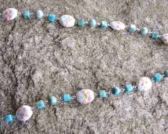 """Necklace 22"""" pink and teal glass painted beads with smaller teal glass beads with silver wire conectors"""