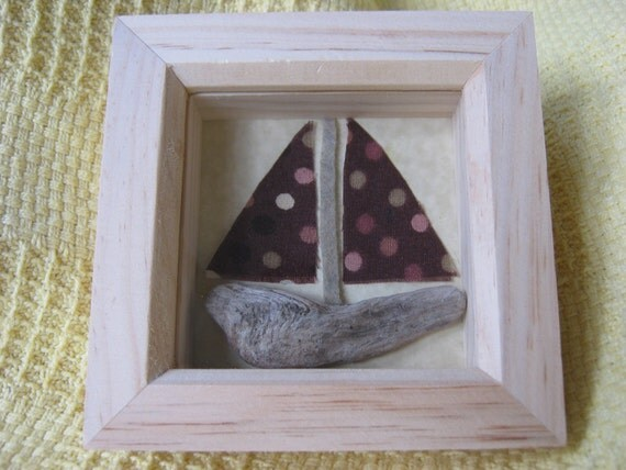 A picture of a handmade driftwood and vintage fabric boat.