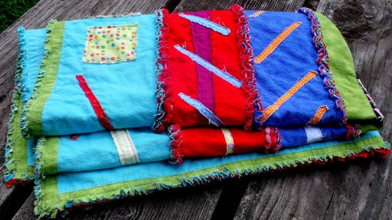 modern rag quilt, colorful small quilt, blue, aqua, green, red quilt