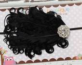 Black feather headband with a fancy center embellishment. Infant, toddler, child, adult sizes