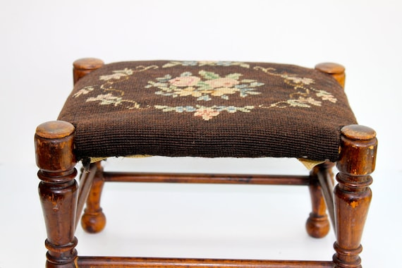 Antique needlepoint prayer and foot stool