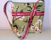 Purse in olive green print with fuchsia accents