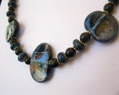 Evensong - An opera length lampwork focal, spacers and black onyx necklace.