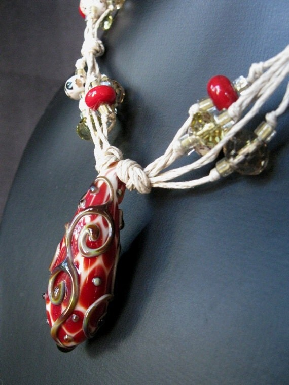 Raku Scrolls - A lampwork focal bead, tied and knotted on hemp.