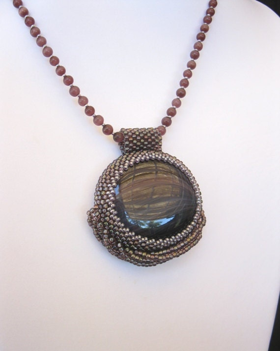 Passion - a bead-bezelled lampwork cabochon.