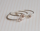 Set of three lowercase initial rings , sterling silver