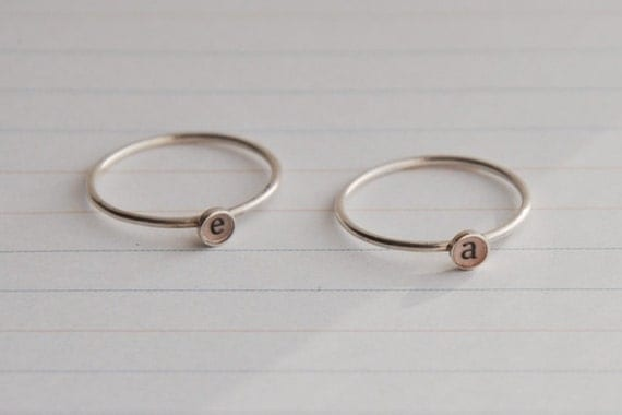 Set of two lowercase initial rings , sterling silver
