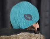 Teal Skullcap with crochet flower and embroidered leaf