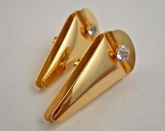 Shiny Gold Tone Abstract Clip On Earrings with Bezel Set Rhinestone.