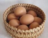 Woven light sallow vessel for eggs