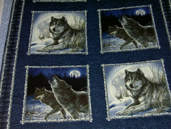 Snowy Wolves with blue trim large throw Canadian Blanket