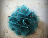teal floral fabric and mesh flower clip