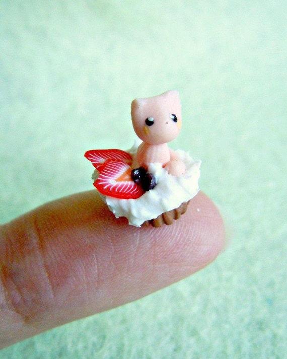 Tiny cupcake kitten - strawberries and whipped cream