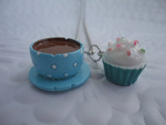 Lovely blue cup and cupcake charm, with a ball chain necklace.