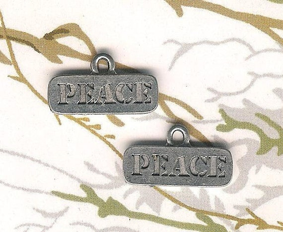 Low Close Out Price-Antique Silver PEACE charm- 4 pieces