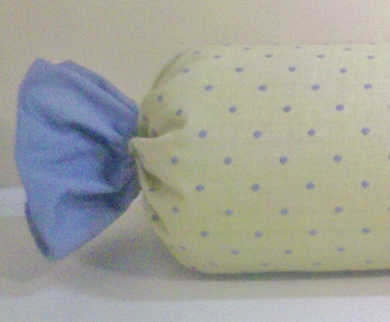 Citron green bolster with blue polka dots and blue candy wrapper ends.