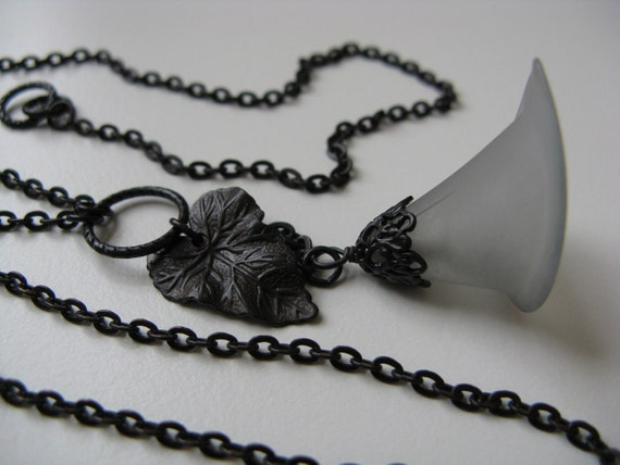 Tempest - stormy gray blue lucite lily flower, art nouveau filigree bead cap, leaf charm, and antiqued black brass necklace