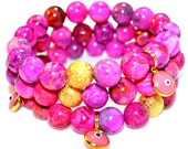 Fuchsia Crazy Lace Semi Precious Gemstone Beaded Bracelet with Gold Stardust Bead and Glass Evil Eye Charm from Turkey