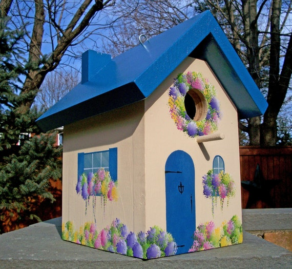 Blue Birdhouse with Spring Flowers
