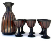 modernist pottery carafe and wine glasses