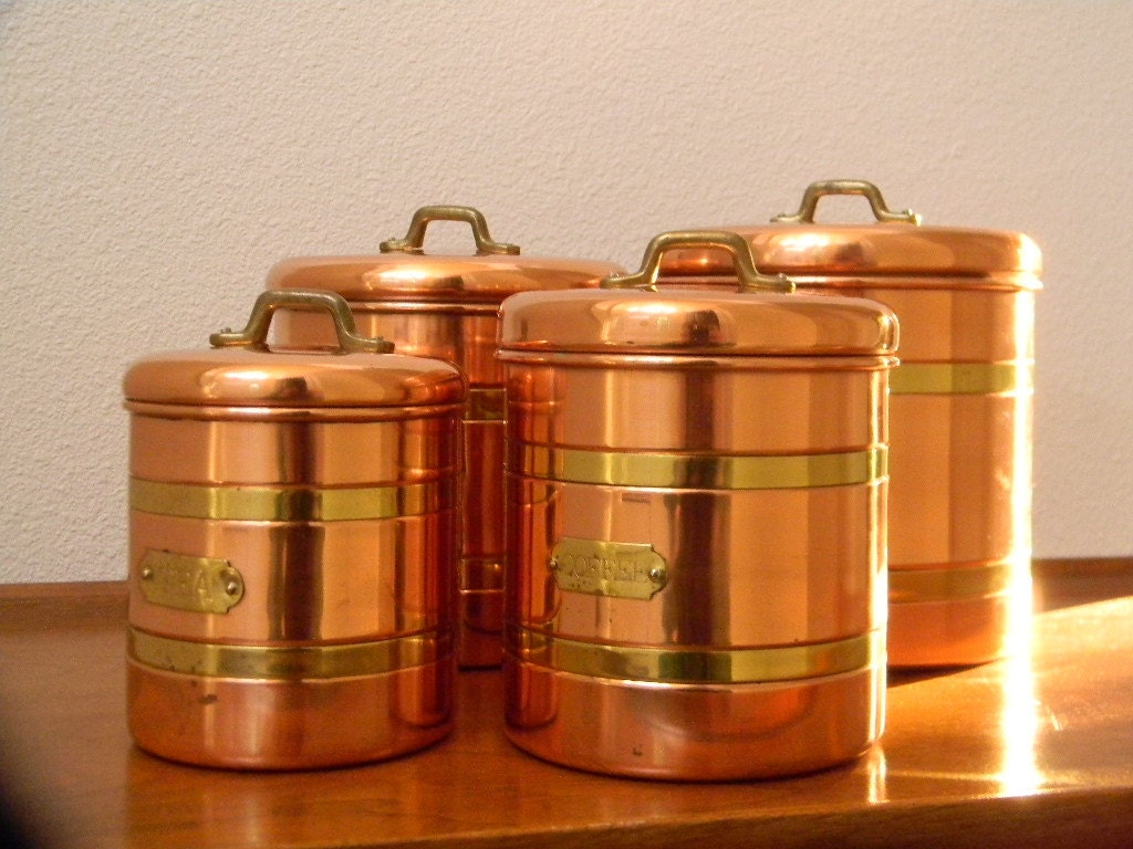 four copper and brass canisters to complete your copper
