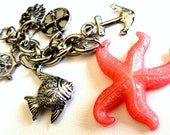 Key Chain with pink starfish pendant and silver finish nautical charms Into the Ocean