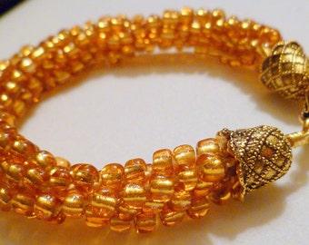 Beaded Kumihimo bracelet - gold/amber color