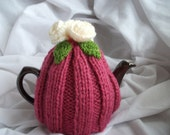 Dusky pink small hand knitted  tea cosy (cozy) with cream flowers.