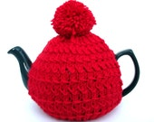 Tea cosy red with pompom to fit a medium tea pot